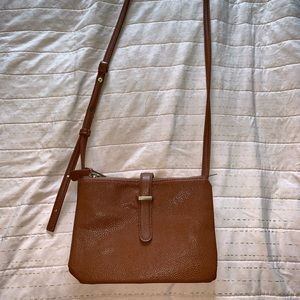 A brown pleather side purse.